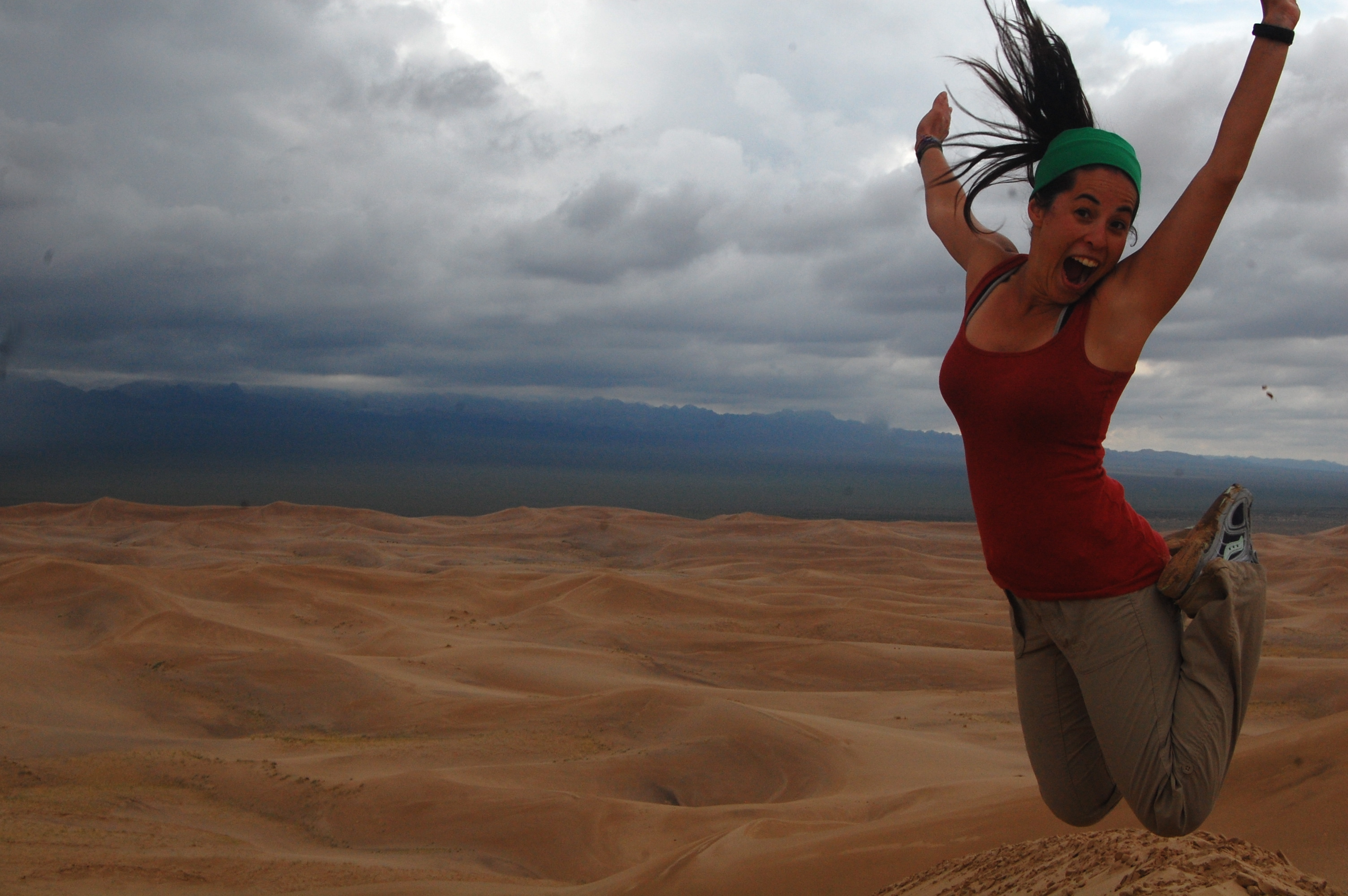 Jumping over the sand dunes of the Gobi Desert in Mongolia