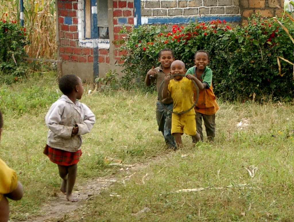 Happy Tanzanian children running and playing
