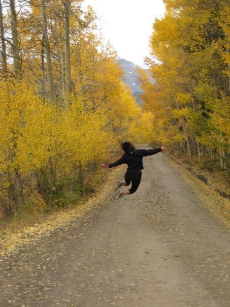 Jumping in the aspens of Breckenridge, Colorado