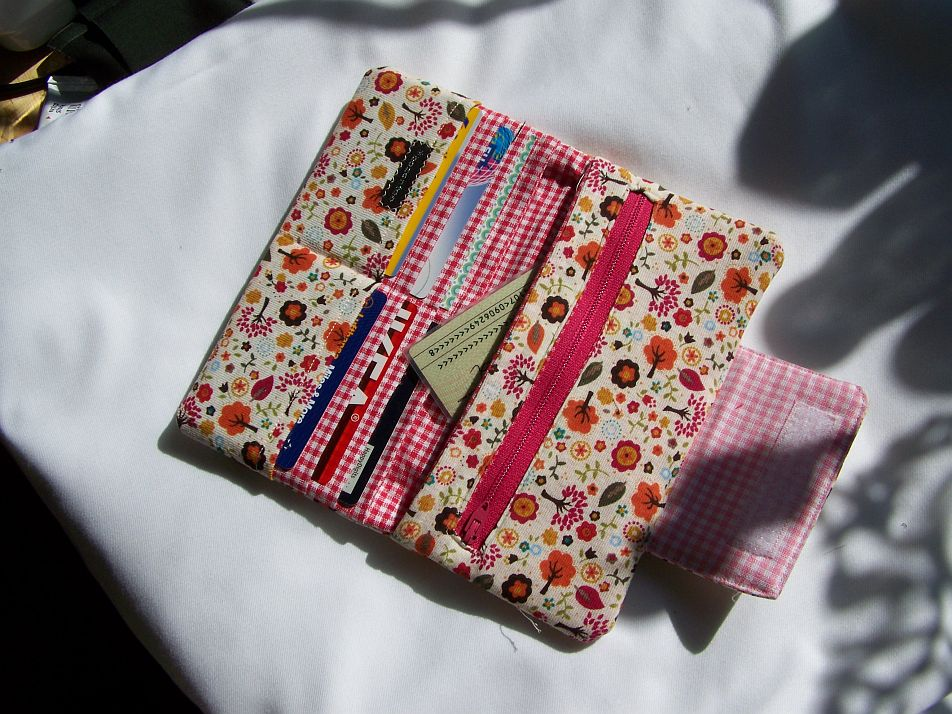 Cute flowered wallet with checkbook sticking out