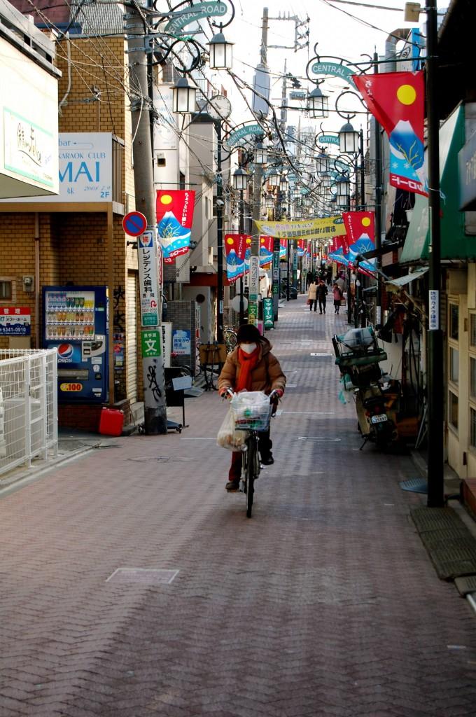 Women biking down streets in Koenij