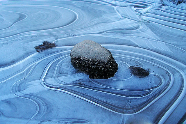 A blue zen garden with rock in Vancouver
