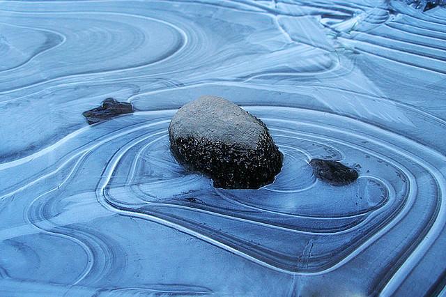 A blue zen garden with rock in Vancouver