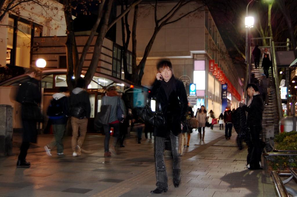 Japanese man walking in Harajuku, Tokyo.
