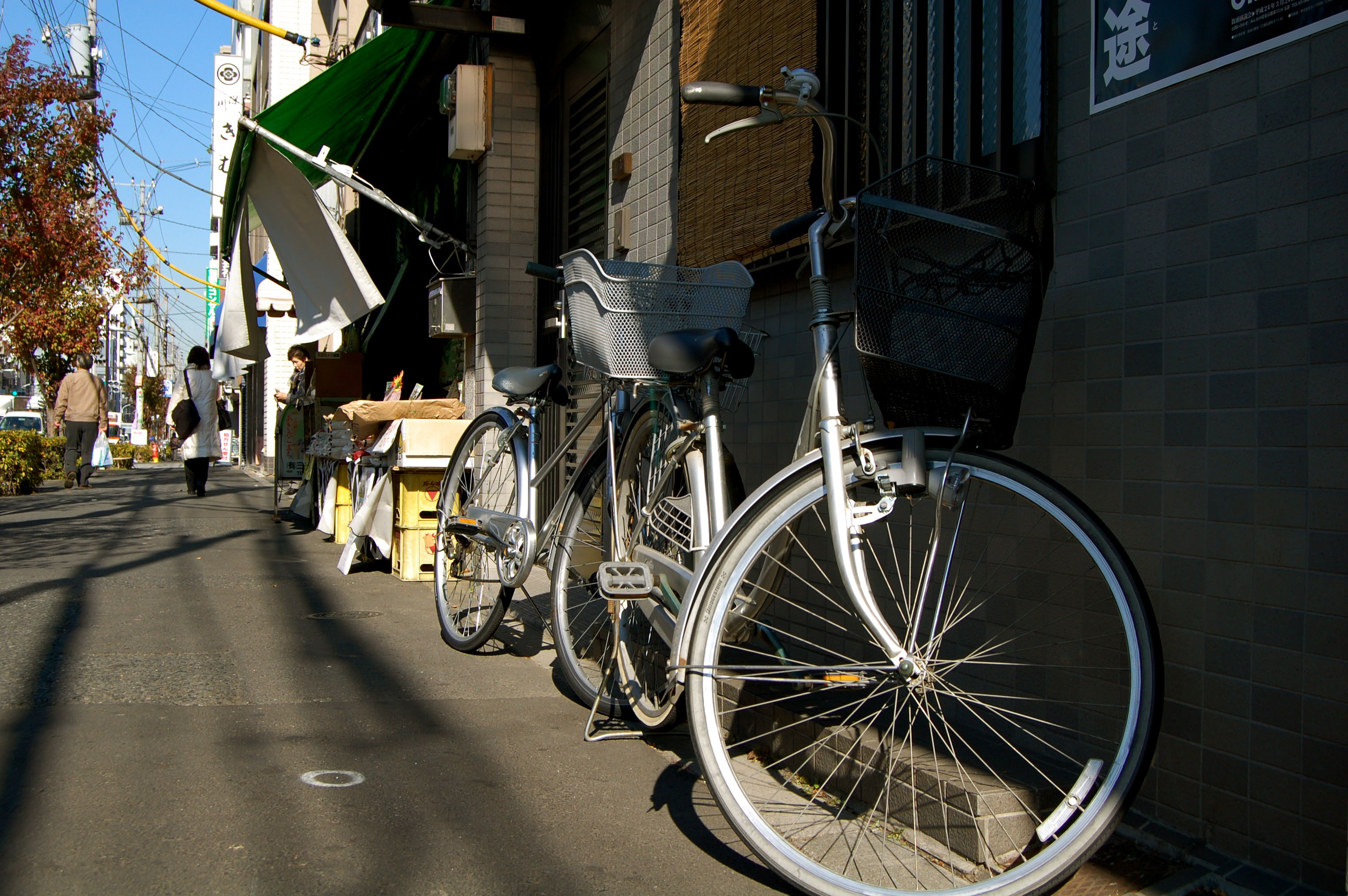 Two bicycles on the sidewalk in Tokyo