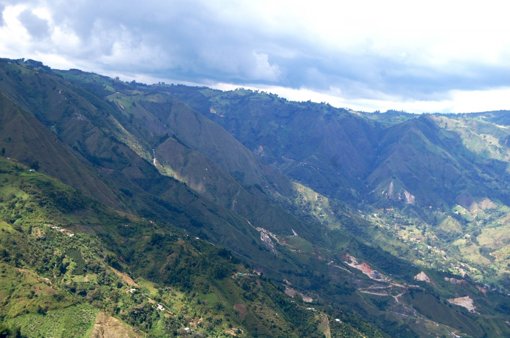 Green mountains of Medellin from a paraglide
