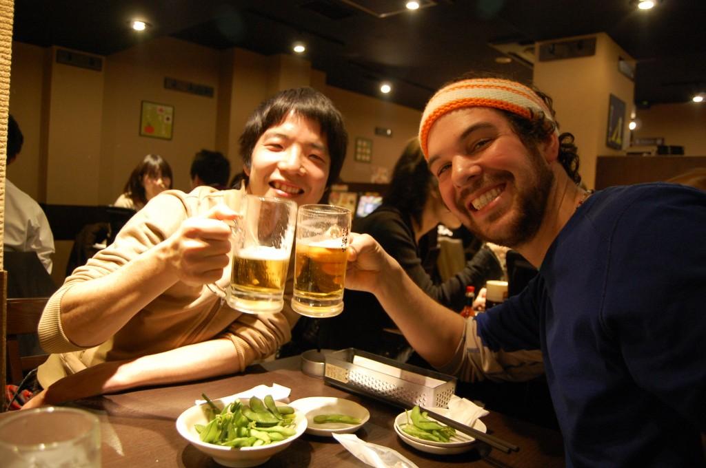Guys drinking Sapporo in Tokyo
