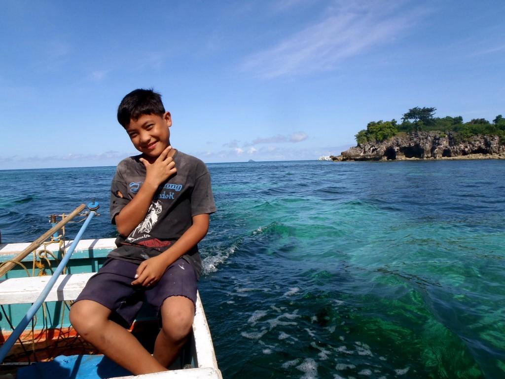 Filipino boy on boat