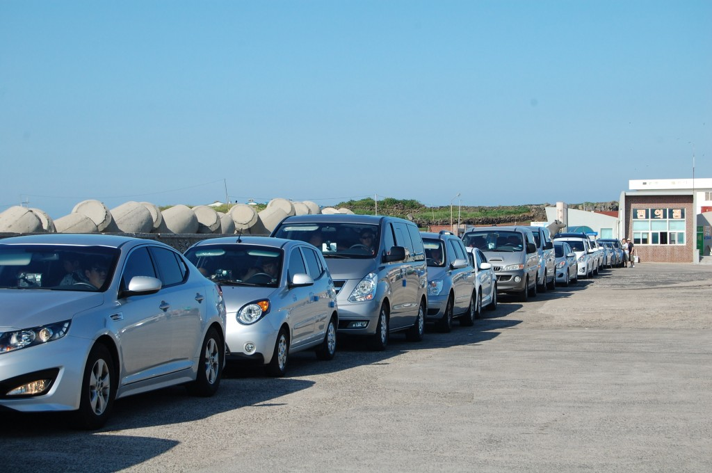 Line of Korean cars in silver, gray, and white