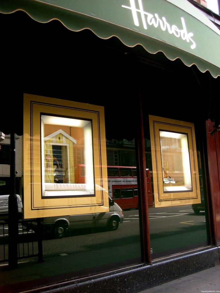 Reflection of double decker bus in Harrod's window