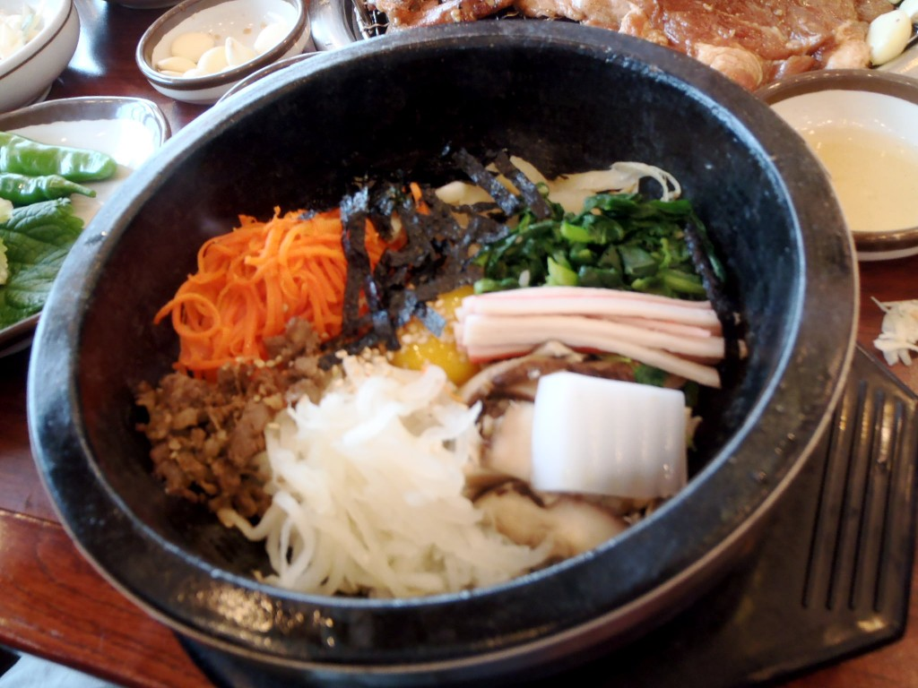 Dolsat bibimbap with egg, carrots, mushrooms