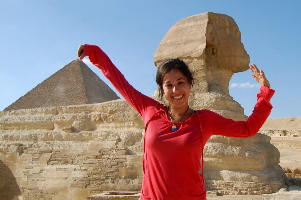 Girl standing with the pyramids and sphinx
