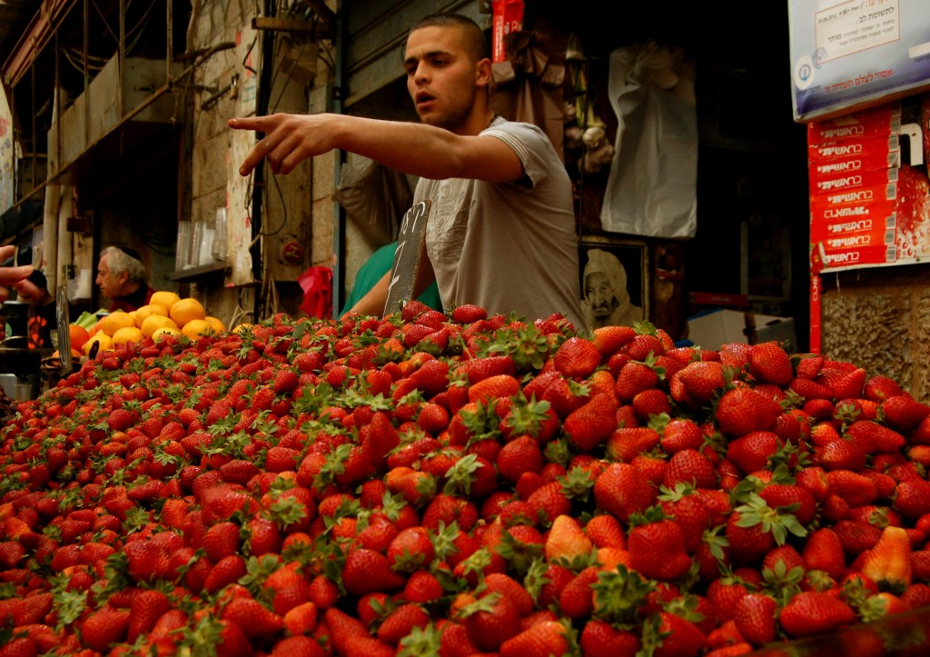 Israeli selling strawberries at a market