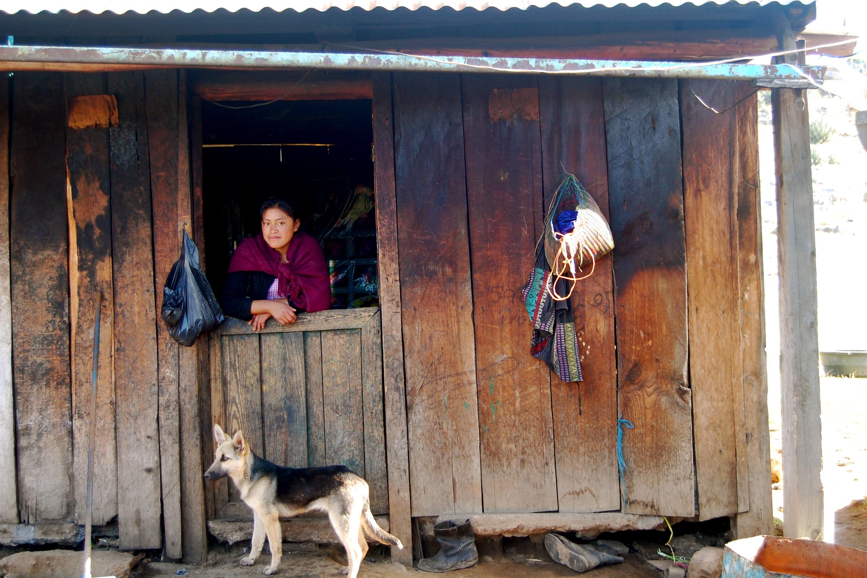 Nicaraguan girl and dog in door