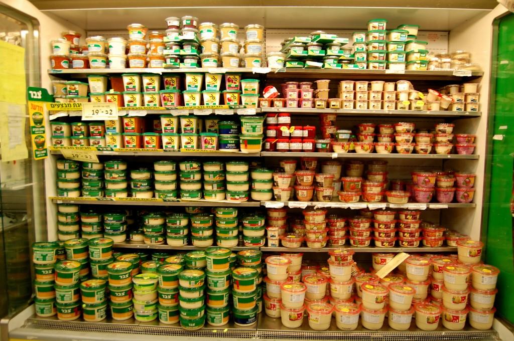 Wall of hummus in Israeli grocery store