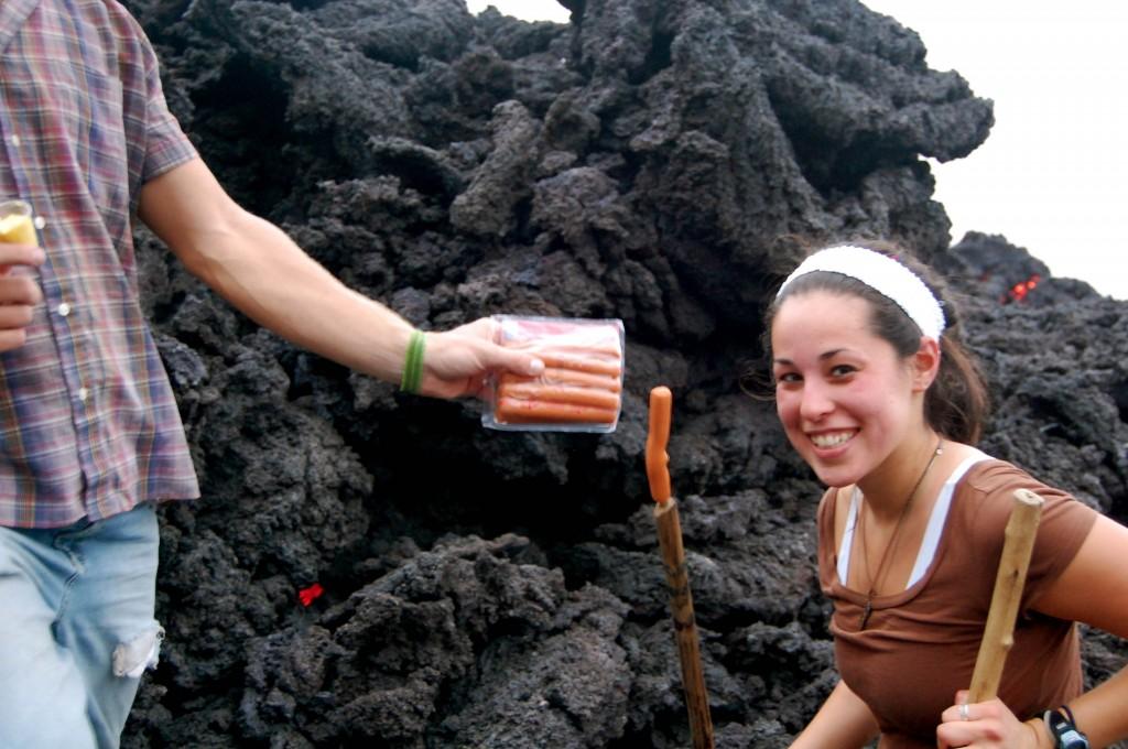 Roasting hot dogs on Pacaya Volcano in Guatemala