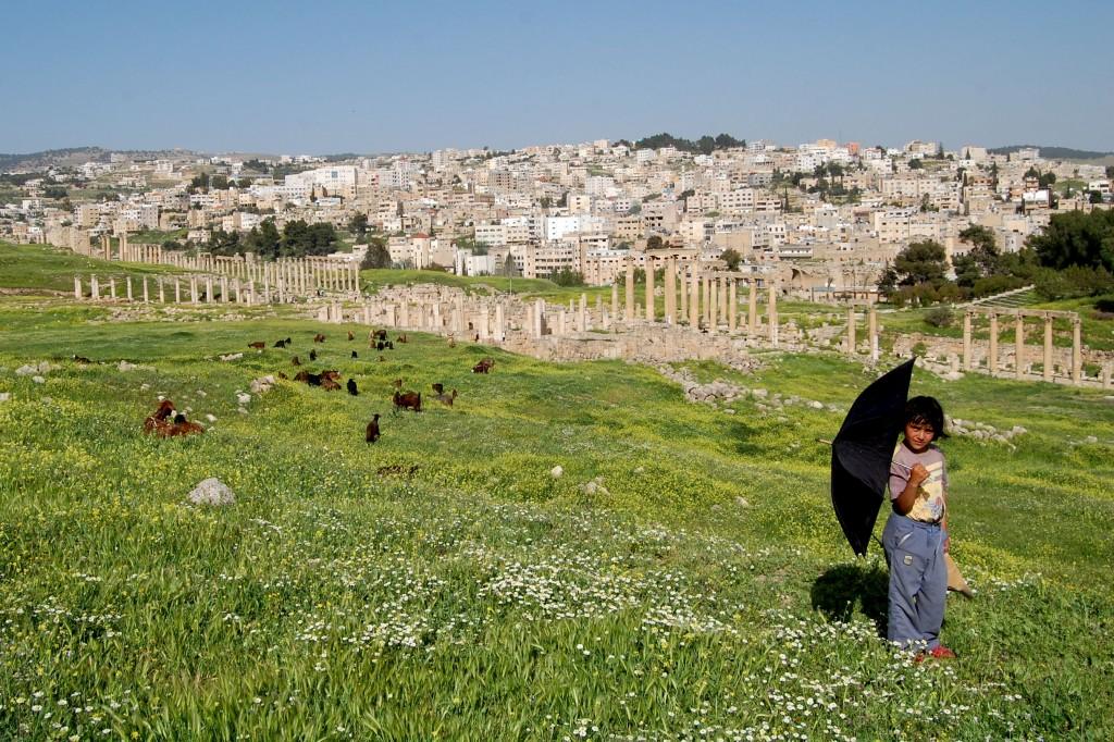 Boy standing at Jerash ruins in Jordan