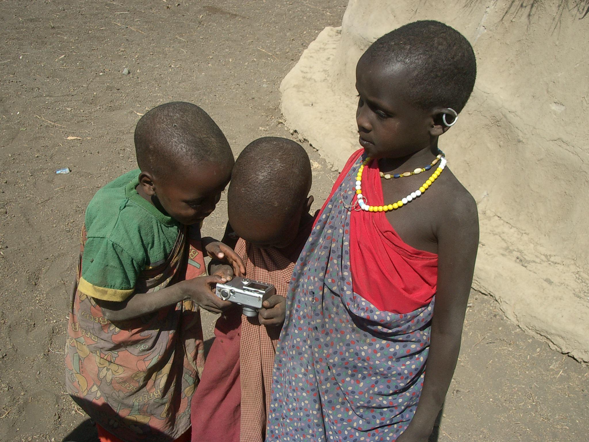Masai kids using camera