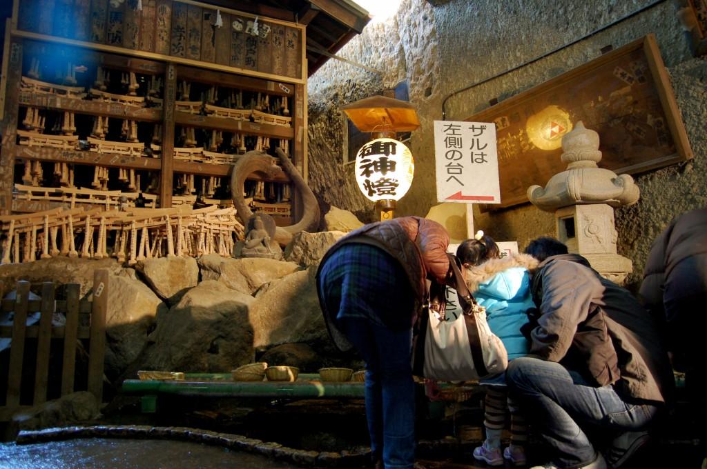 Family at the Zeniarai Benten shrine in Kamakura, Japan