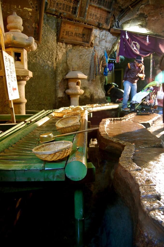 Washing money at the Zeniarai Benten shrine