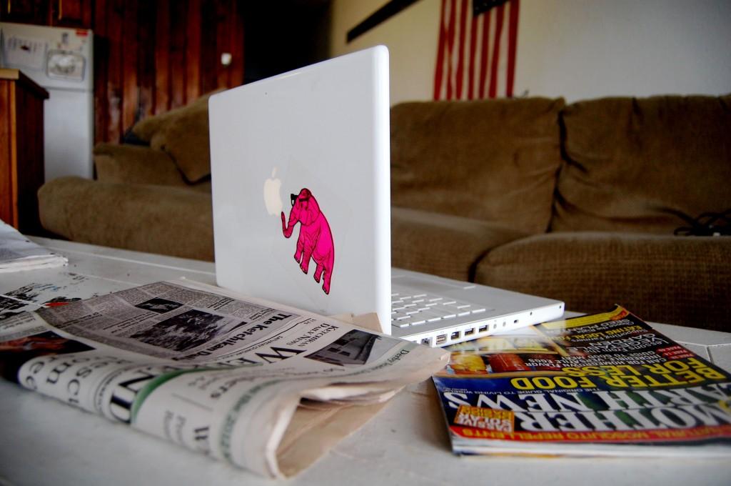 Juxtaposed media: laptop, magazine, newspaper