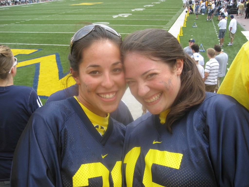 Girls in jerseys at a Michigan football game