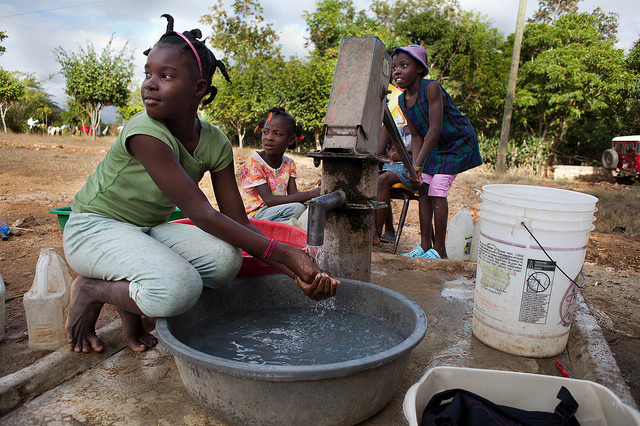 Girls at well in Haiti