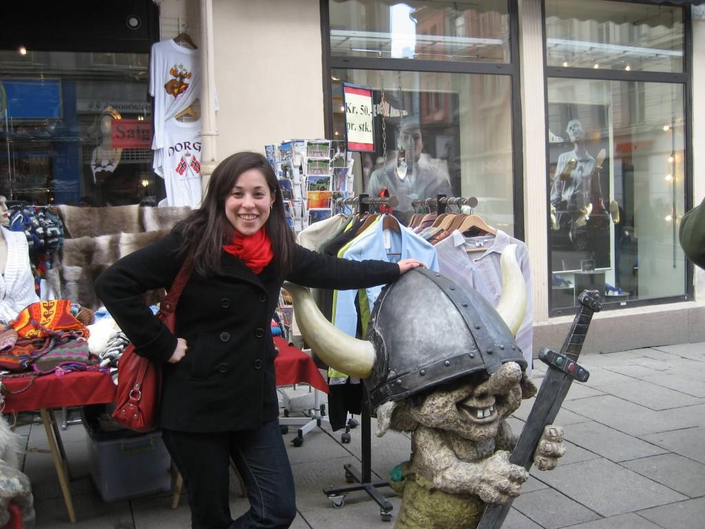 Girl with Norwegian viking statue