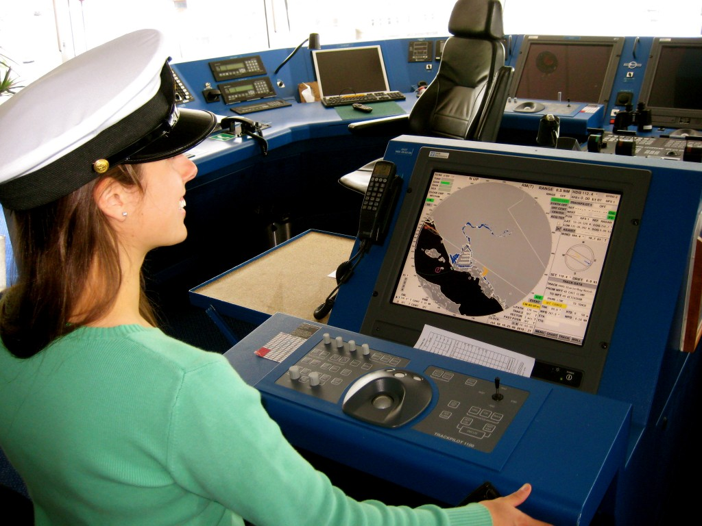 Girl at helm of cruise ship