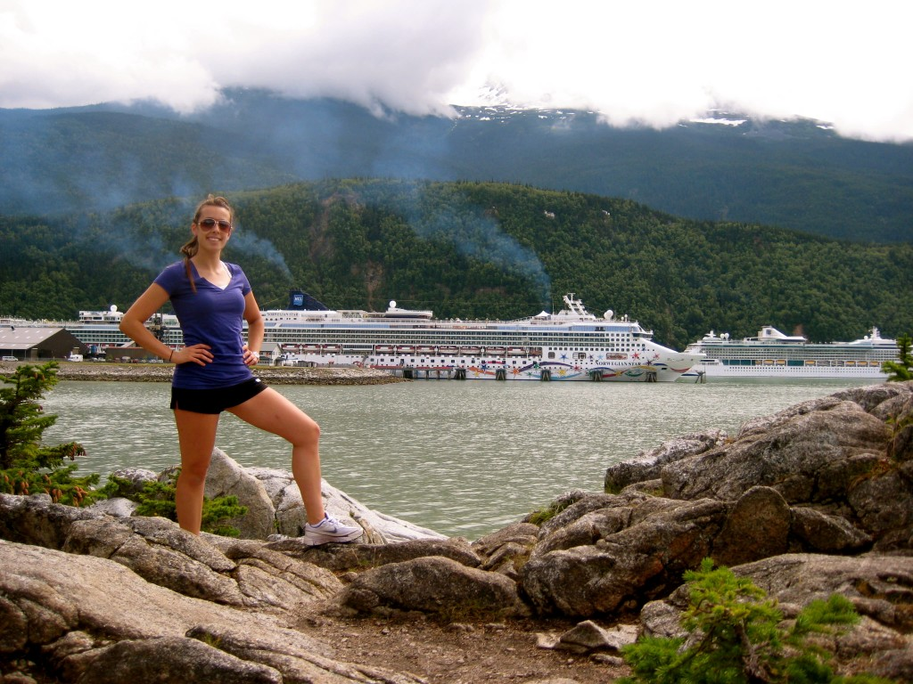 Girl in Alaska with cruise ship in background
