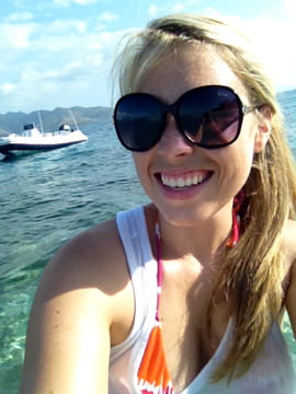 Arielle in the Gili Islands, Indonesia, witht he tender in the background
