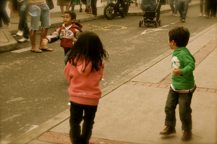 Kids chasing bubbles in Colombia.