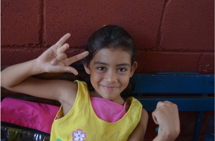 My Nicaraguan student, Ashley, knows how to smile. (And throw gang signs.)