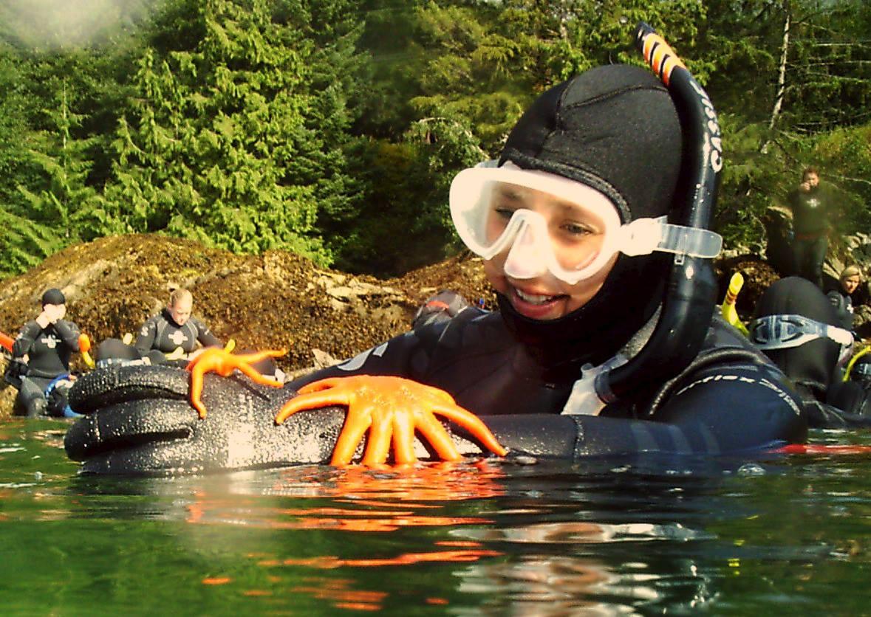 Girl with starfish scuba