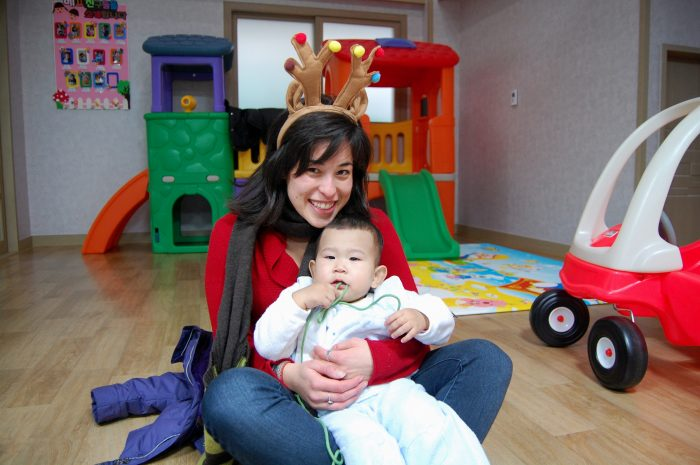 Christmas at a Korean orphanage two years ago. Look past the awful haircut to the chubby baby + reindeer antlers!