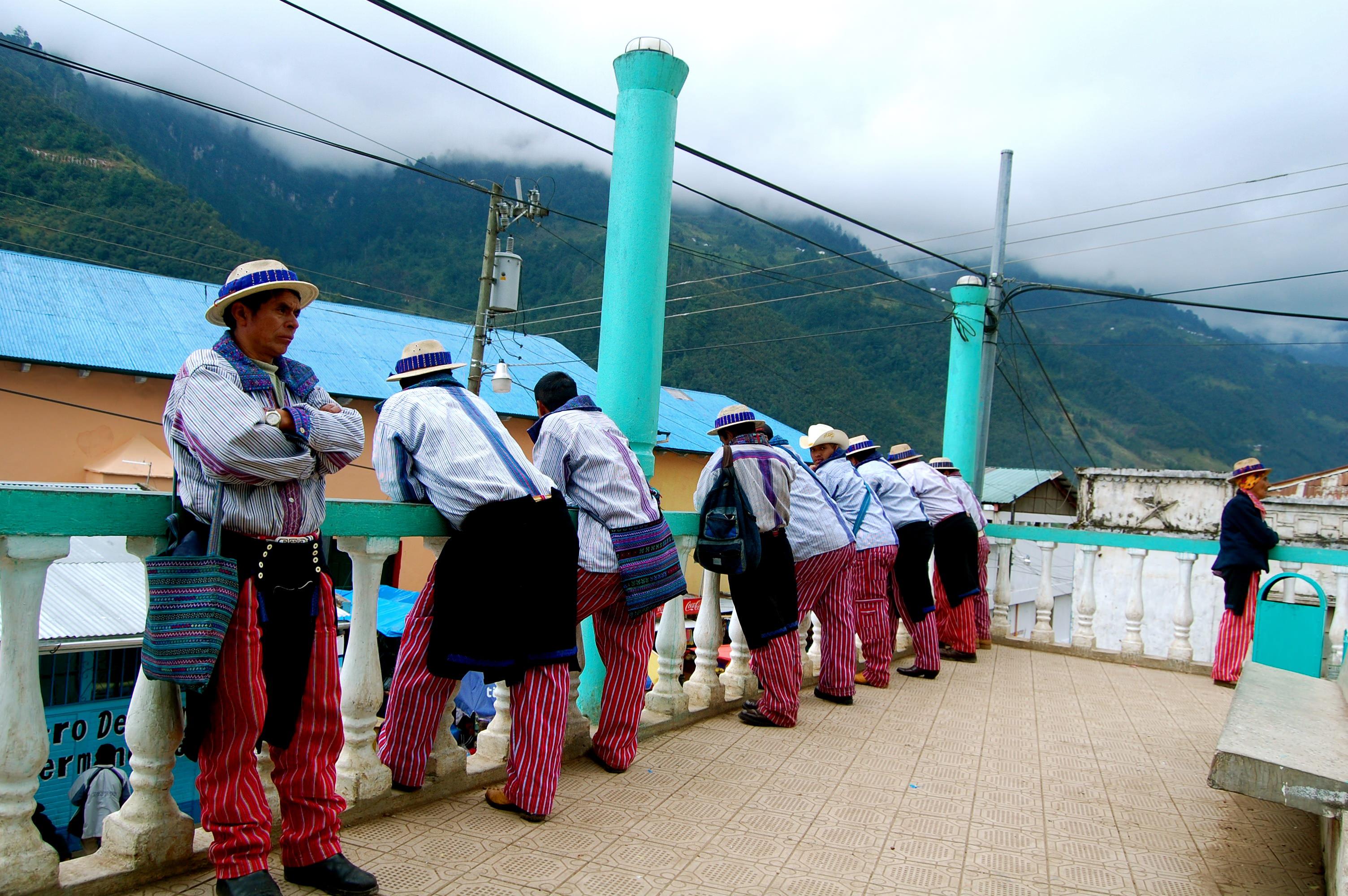 Men in traditional clothing in Todos Santos, Guatemala
