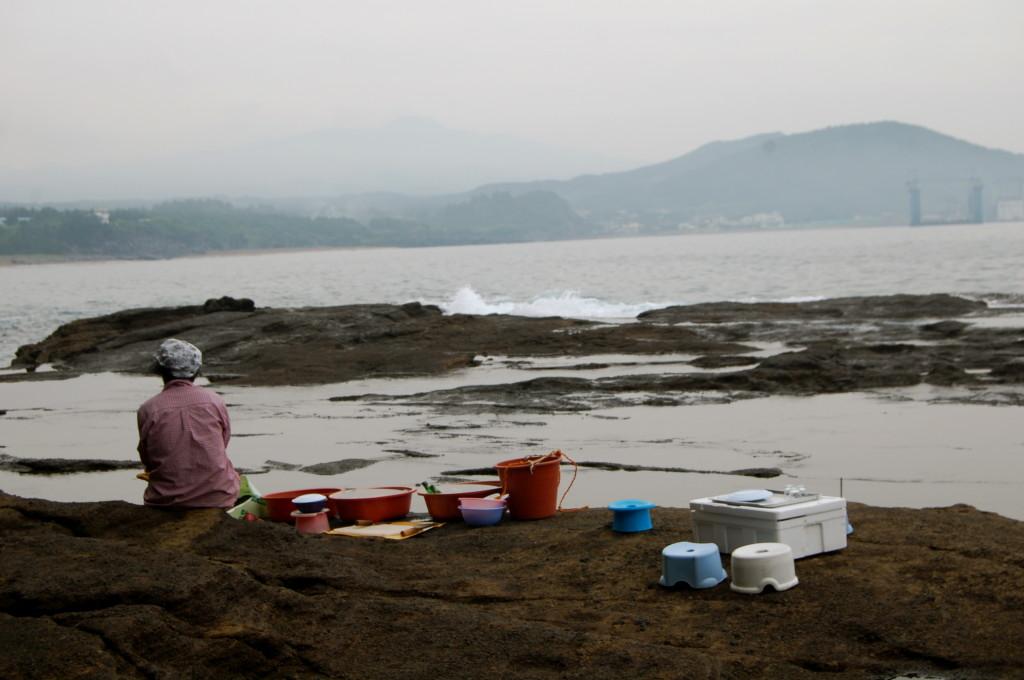 Korean haenyo diver on beach