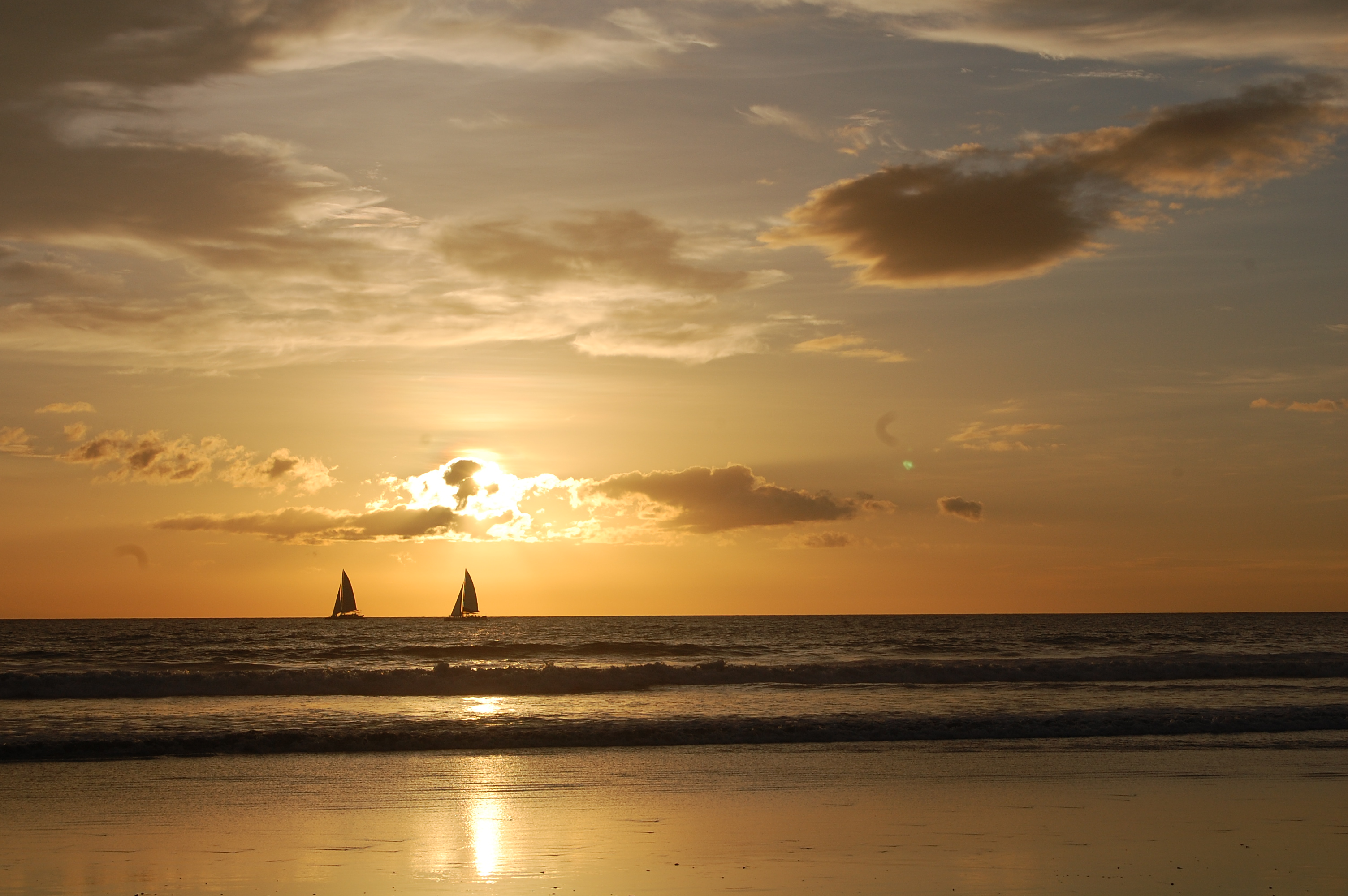 Sailboats and sunset in Nosara, Costa Rica